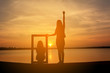 Silhouette of women holding frame at the sky sunset concept valentine day