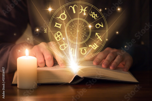 man reading astrology book