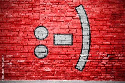 :-) Smiley Ziegelsteinmauer Graffiti