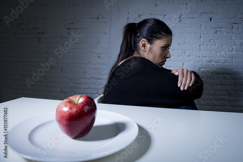 young woman or teen with apple fruit on dish as symbol of crazy diet in nutritio Canvas Print