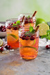 Refreshing winter drink with lime and cranberry