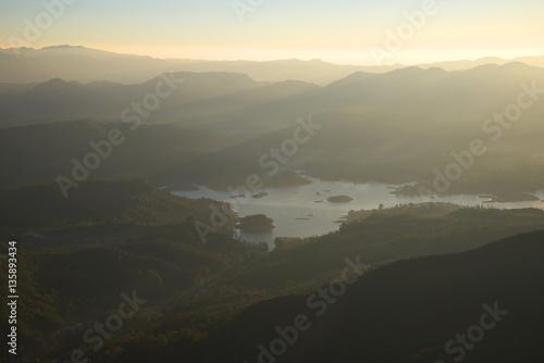 Fototapety, obrazy: Foggy sunrise over a mountain lake. Adam's peak, Sri Lanka