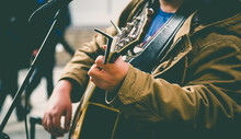 Street Musician Playing Guitar. London Lifestyle