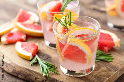 фотографія  Refreshing drink, grapefruit and rosemary cocktail