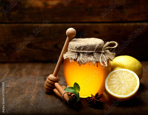 Honey, ginger, lemon and spices on a wooden   background Wallpaper Mural
