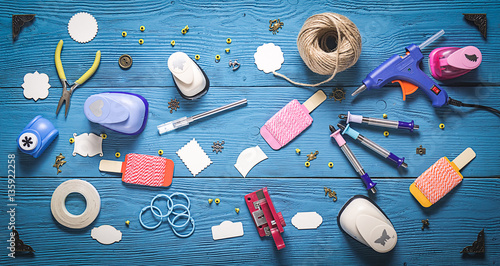 Obraz top view of wooden table with tools for scrapbooking - fototapety do salonu