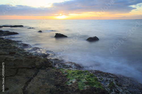 Sea coast in a long exposure shot, with blurred water Poster