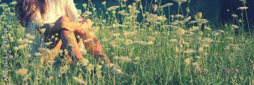 Foto auf Gartenposter Khaki Detail of beautiful girl sitting on green meadow full of elders flowers in spring