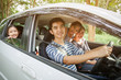 Happy Asian family on mini van are smiling and driving for travel on vacation