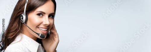Fototapeta customer support phone operator in headset, against grey obraz