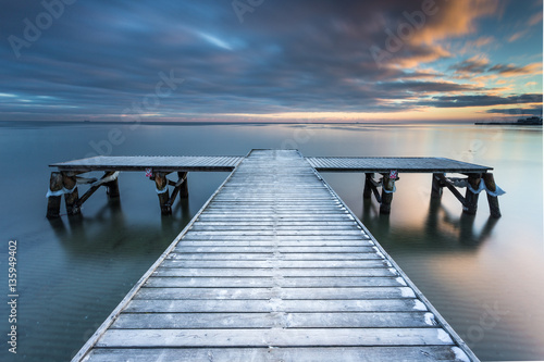 Early morning at frozen small pier at beach in Sopot. Winter landscape in Sopot, Poland.