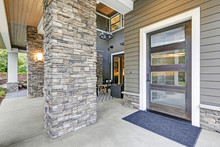 Covered Porch Accented With Stone Column