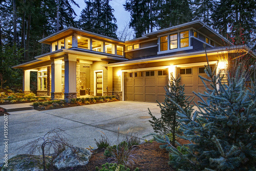 Luxurious new construction home exterior at sunset