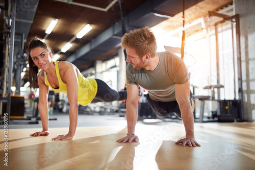 Valokuva  Female and male doing exercises for strengthen hands