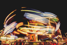 A Fair Ride During Dusk On A Warm Summer Evening Toned With A R