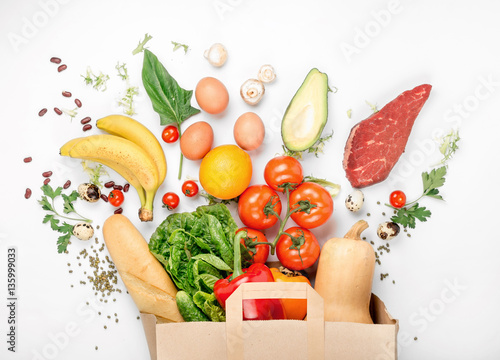 Poster Cuisine Full paper bag of different health food on white background