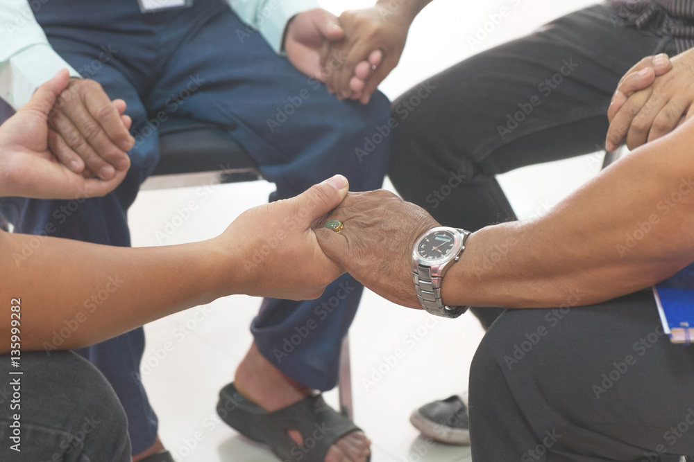 Fototapety, obrazy: group of different men praying together, color filter added.