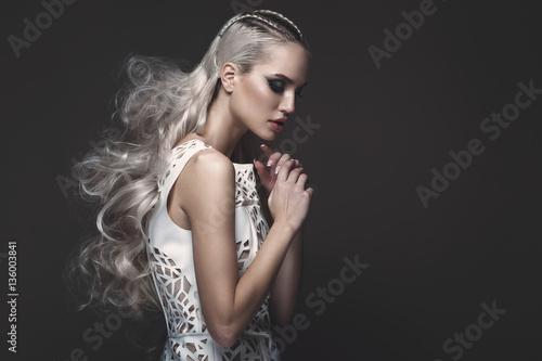 Vászonkép Beautiful girl in art dress with avant-garde hairstyles