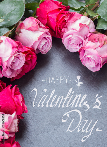 Blooming Dark And Pink Roses Laying On Black Stone Table With With