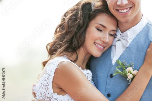 Fotografie, Obraz  Portrait of beautiful happy bride on blurred background, close up view