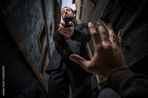 Mafia killer murdering an innocent Fototapeta