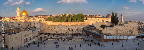Temple Mount panoramic view in the old city of Jerusalem at sunset, including the Western Wall and golden Dome of the Rock.