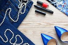 Jeans, Shoes And Perfume On The Wooden Background