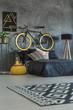 Leinwandbild Motiv Grey student bedroom with bike