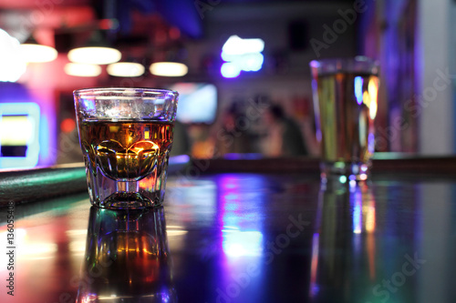 Fotografie, Obraz  Shot of whiskey and a beer at a dive bar.