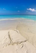 Waves Wash Away A Heart Drawn ...