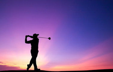 silhouette golfer playing g...