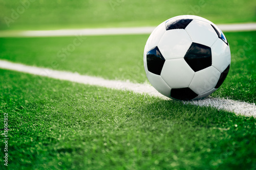 Deurstickers Bol Soccer ball on soccer field