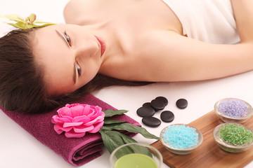 Obraz na płótnie Canvas Spa. Care Facial. Beautiful Young Woman Getting a Face Treatment at Beauty Salon