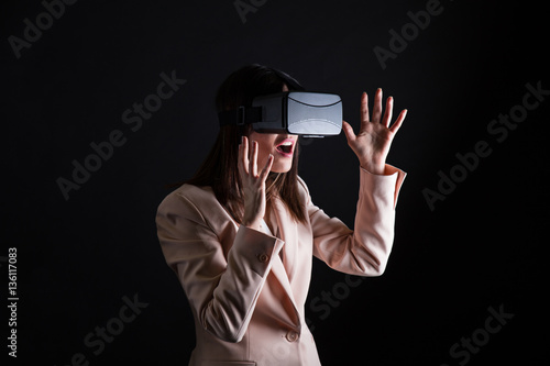 278f4229d49 Businesswoman playing virtual reality simulation - Buy this stock ...