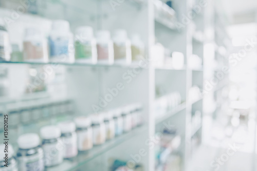 Photo sur Toile Pharmacie Pharmacy blurred light tone with store drugs shelves interior background, Concept of pharmacist and chemist.