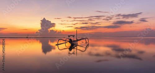 Tuinposter Bali Sunrise at Sanur Beach Bali, Indonesia with traditional balinese jukung boat