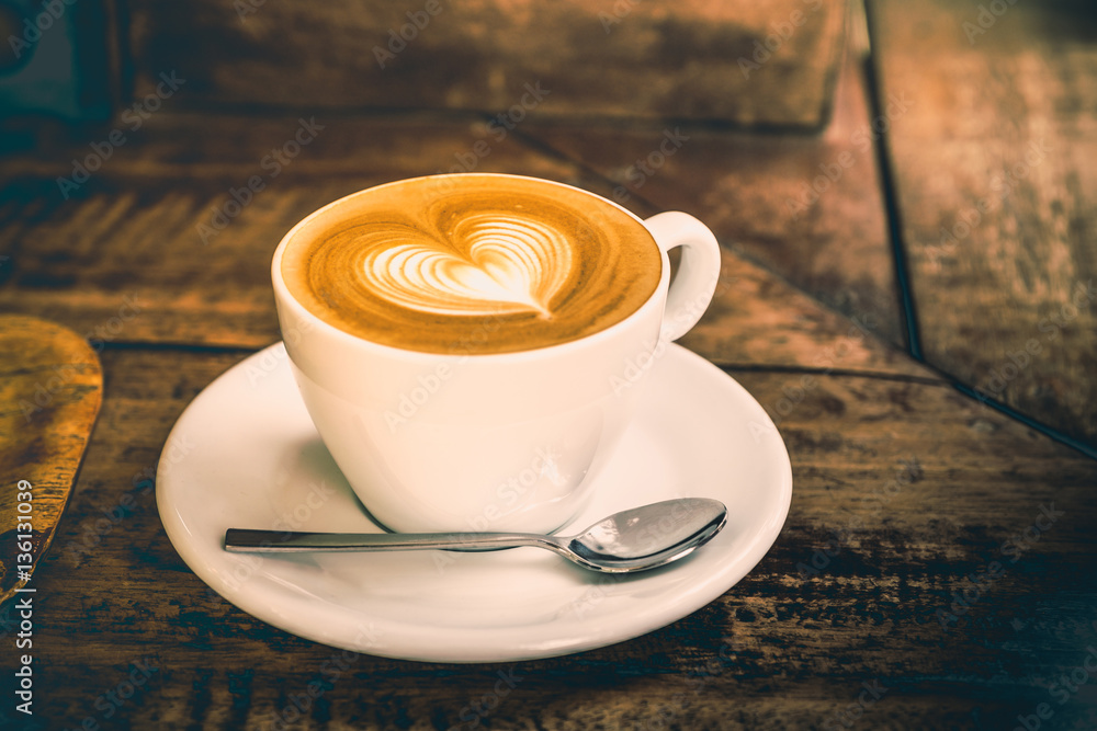 Drak tone filter,Close up white coffee cup with heart shape latt
