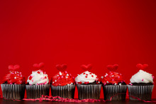 Cupcakes Set Many For Valentines On Red Close Up Hearts