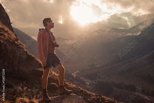 Fototapeta Man Traveler hiking Travel Lifestyle concept beautiful mountains landscape on background Summer journey adventure vacations outdoor obraz na płótnie