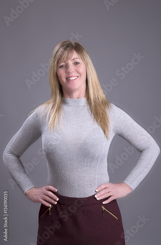 Attractive Middle Aged Busty Woman With Hands On Waist -3650