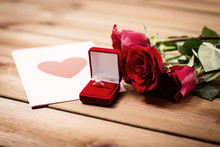 Close Up Of Diamond Ring, Roses And Greeting Card