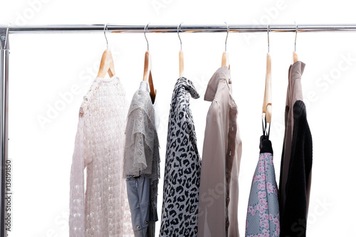 d8dcb84bb6f grey and beige womens clothes on hangers on rack on white backgr ...