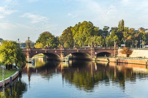 Photo view to historic sandstone Moltke Bridge in Berlin