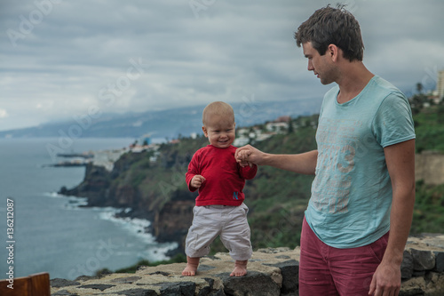 Father with baby on the coast of Los Realejos, north of Tenerife, Canary Islands