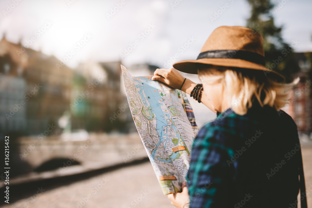 Fototapety, obrazy: Young tourist woman searching right direction on map