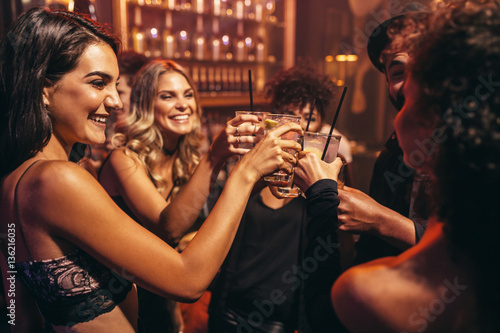 Young people with cocktails at nightclub Canvas Print
