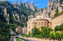View The Famous Catholic Monastery Of Montserrat On The Backgrou