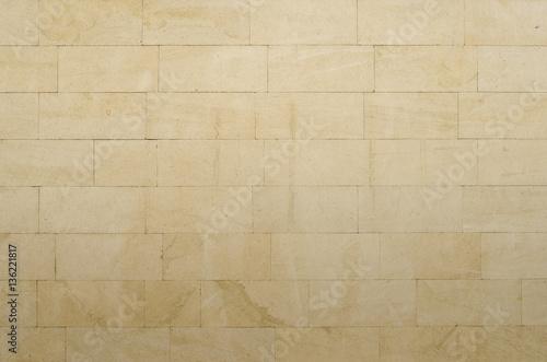 Background of gray-yellow porous sandstone blocks Canvas Print