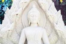 Close-Up Of Marble Buddha Statue With Naga Heads