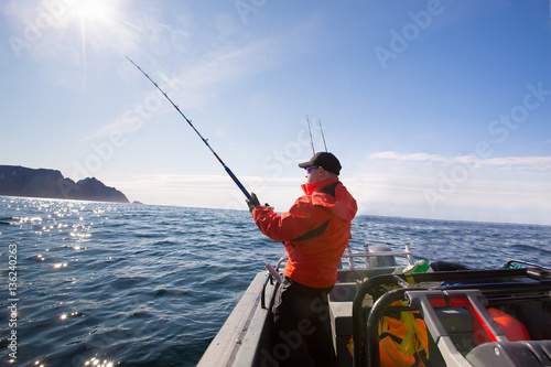 Stampa su Tela Fisherman catches athlete middle of the sea with boats